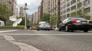 cars-driving-in-park-avenue-traffic-in-midtown-manhattan-low-street-view-on-ground-crosswalk-lines-nyc-1080-hd_4yr7p_a7__S0000